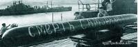 Погрузка торпеды на подводную лодку